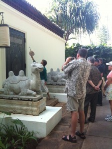 Visitors snap photos before entering Doris Duke's Shangri La in Honolulu Hawaii