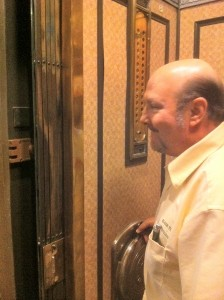 Larry runs the manual elevator in the Tower Building home to Elgin Technology Center