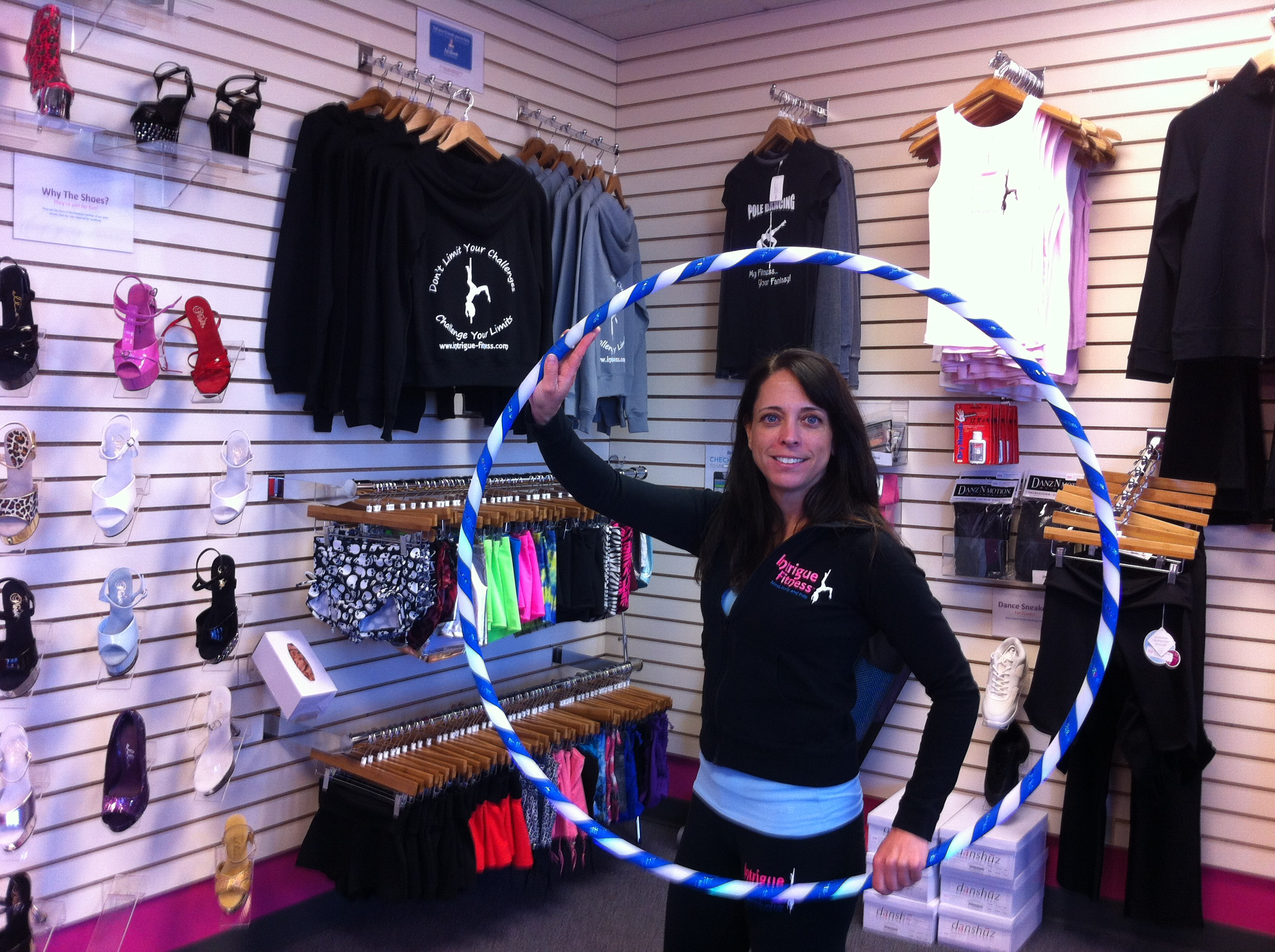 Owner Linda Costoff shows one of the Hula Hoops at Intrigue Fitness